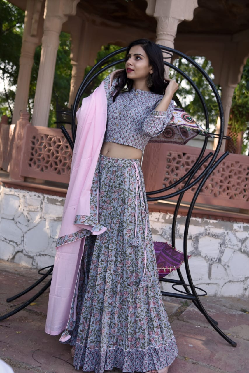 Shop beautiful grey hand block Bagru block print skirt set with pink dupatta. Shop designer Indian clothing, designer lehengas, designer Anarkali, gharara suits, palazzo suits, Indian dresses in USA from Pure Elegance Indian fashions store for parties and special occasions.-standing