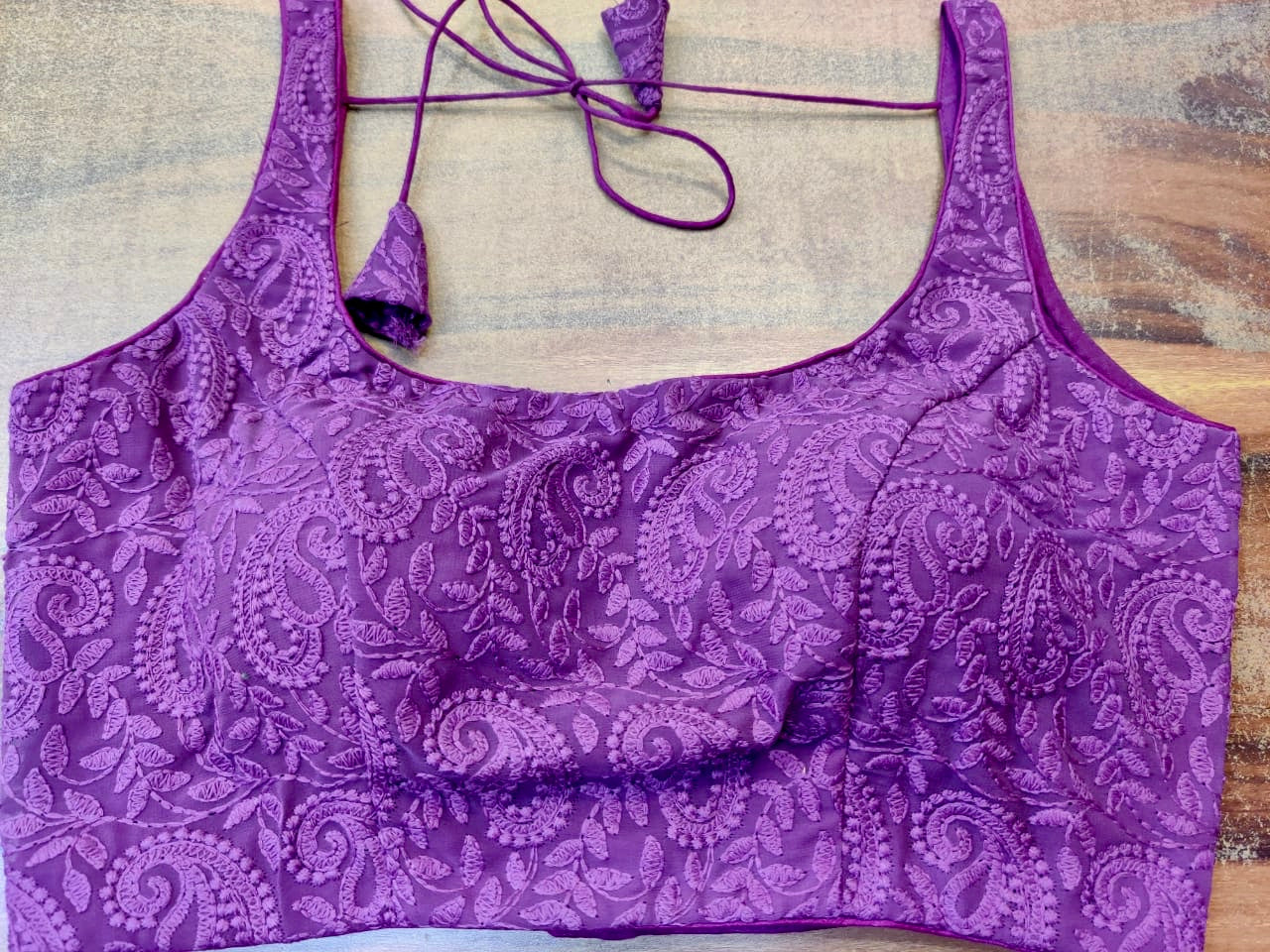 Buy stunning purple embroidered sleeveless saree blouse online in USA. Elevate your ethnic saree style with a tasteful collection of designer saree blouses, embroidered sari blouses, Banarasi blouses, silk saree blouses from Pure Elegance Indian clothing store in USA.-front