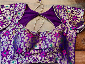Buy stunning purple Benarasi silk designer saree blouse online in USA. Elevate your ethnic saree style with a tasteful collection of designer saree blouses, embroidered sari blouses, Banarasi blouses, silk saree blouses from Pure Elegance Indian clothing store in USA.-front