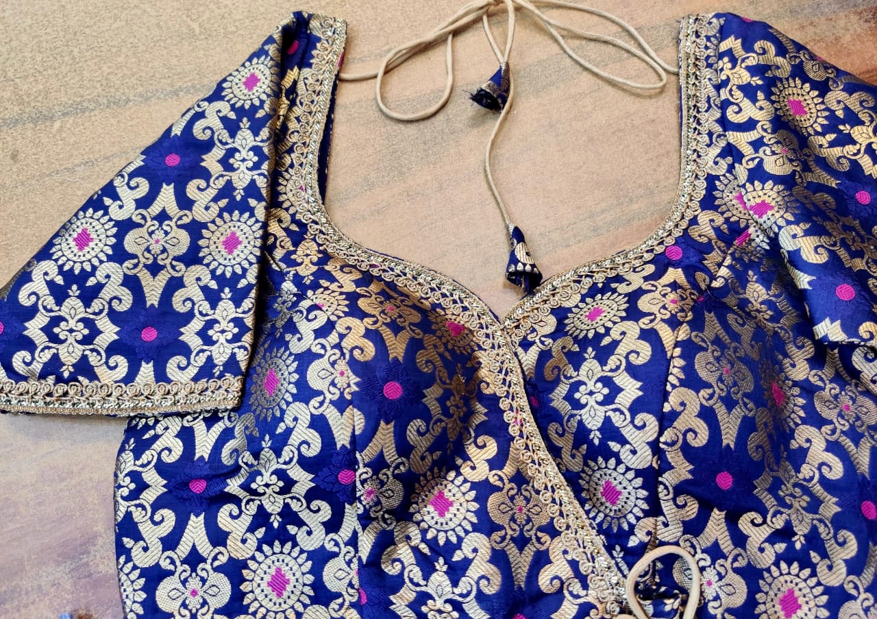 Shop beautiful blue Benarasi silk designer sari blouse online in USA with golden lace. Elevate your ethnic saree style with a tasteful collection of designer saree blouses, embroidered sari blouses, Banarasi blouses, silk saree blouses from Pure Elegance Indian clothing store in USA.-front