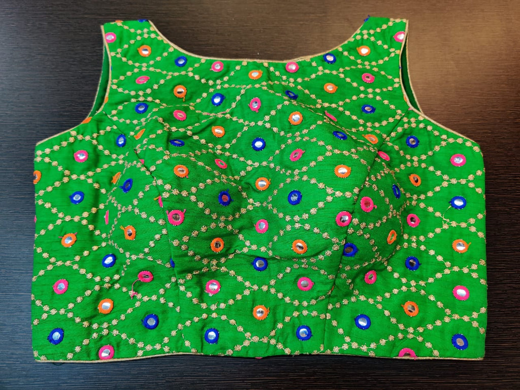 Buy beautiful green mirror work sleeveless saree blouse online in USA. Elevate your Indian saree style with exquisite readymade saree blouses, embroidered saree blouses, Benarasi sari blouse, fancy saree blouse from Pure Elegance Indian clothing store in USA.-front