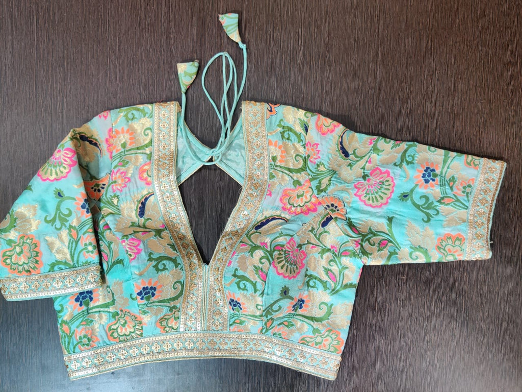 Buy beautiful pastel green Banarasi sari blouse online in USA with embroidered lace. Elevate your Indian saree style with exquisite readymade sari blouse, embroidered sari blouses, Banarasi sari blouse, designer sari blouse from Pure Elegance Indian clothing store in USA.-front
