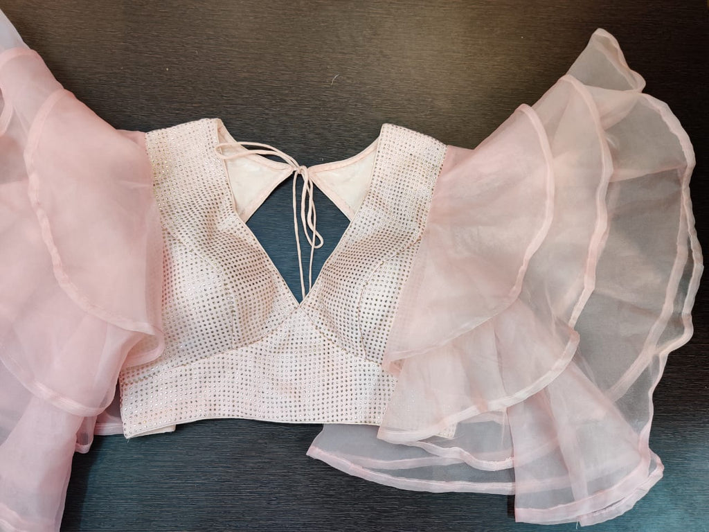 Buy powder pink designer saree blouse online in USA with ruffle sleeves. Elevate your Indian saree style with exquisite readymade sari blouse, embroidered saree blouses, Banarasi sari blouse, designer sari blouse from Pure Elegance Indian clothing store in USA.-full view