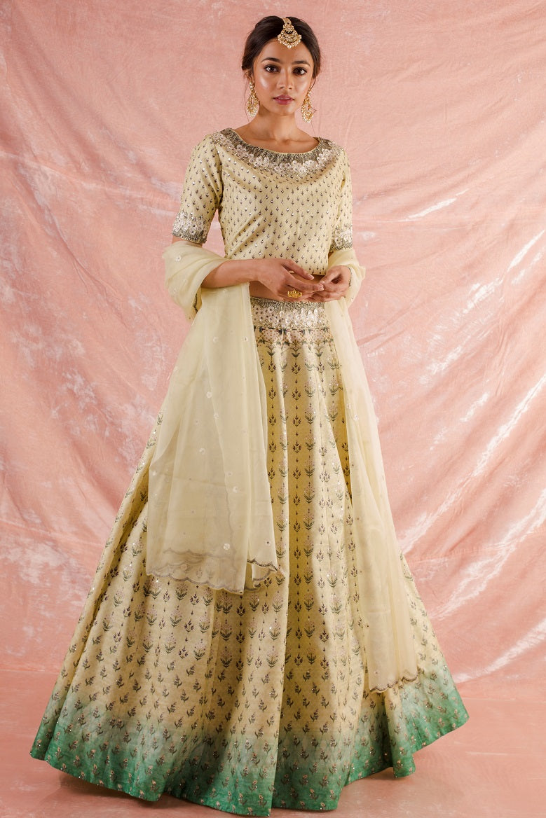 Buy beautiful off-white embroidered silk lehenga online in USA. Lehenga has fine simple yet heavy  embroidery work specially around the neck and has raglan sleeves. Be the talk of parties and weddings with exquisite designer lehengas from Pure Elegance Indian clothing store in USA.Shop online now.-full view