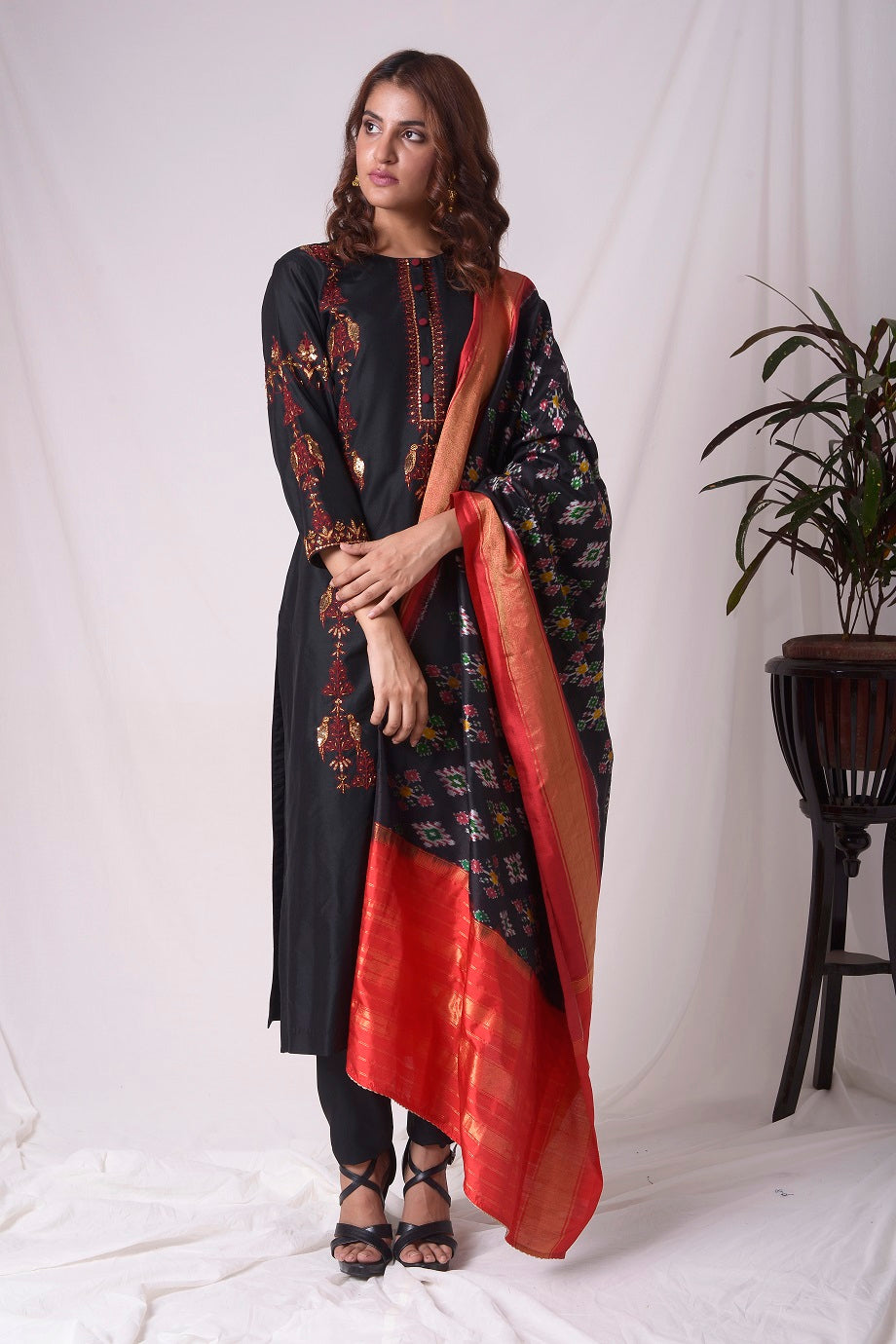 Buy black cotton silk suit online in USA. Suit has simple red  work. Be the talk of parties and weddings with exquisite designer gowns, Indian suits, Anarkali dresses, Indowestern dresses from Pure Elegance Indian clothing store in USA.Shop online now.-full view