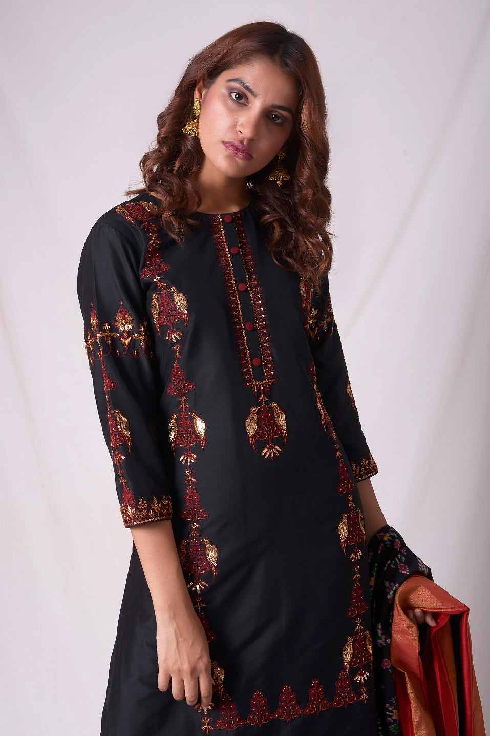 Buy black cotton silk suit online in USA. Suit has simple red  work. Be the talk of parties and weddings with exquisite designer gowns, Indian suits, Anarkali dresses, Indowestern dresses from Pure Elegance Indian clothing store in USA.Shop online now.-close up