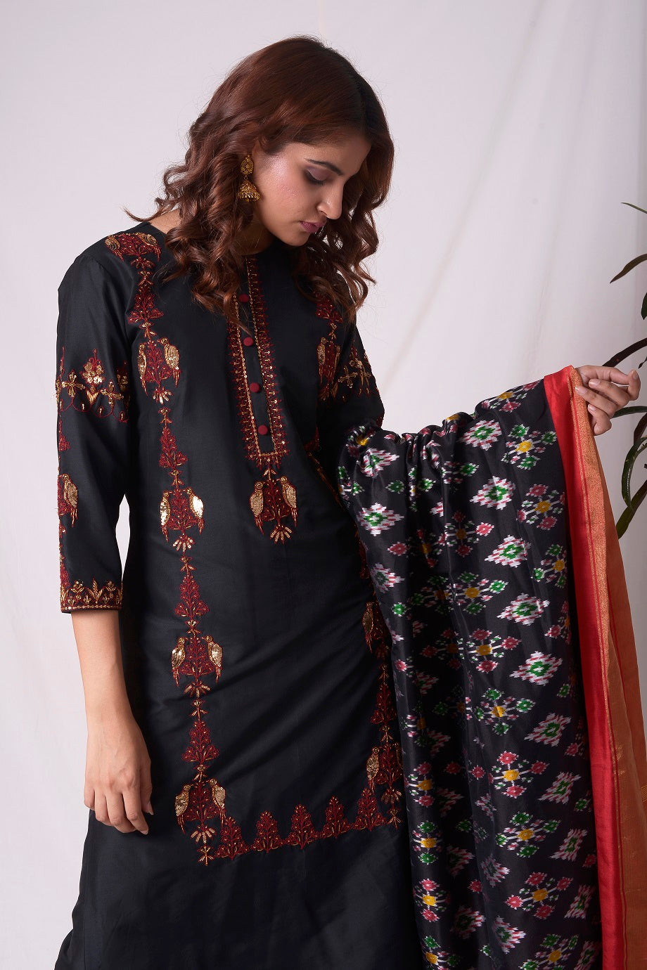 Buy black cotton silk suit online in USA. Suit has simple red  work. Be the talk of parties and weddings with exquisite designer gowns, Indian suits, Anarkali dresses, Indowestern dresses from Pure Elegance Indian clothing store in USA.Shop online now.-closeup2