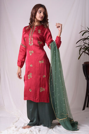 Buy red and green satin suit online in USA with palazzo and dupatta. Be the talk of parties and weddings with exquisite designer gowns, Indian suits, Anarkali dresses, Indowestern dresses from Pure Elegance Indian clothing store in USA.Shop online now.-side view