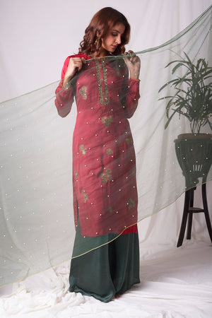 Buy red and green satin suit online in USA with palazzo and dupatta. Be the talk of parties and weddings with exquisite designer gowns, Indian suits, Anarkali dresses, Indowestern dresses from Pure Elegance Indian clothing store in USA.Shop online now.-side view-2