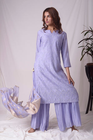 Buy blue chanderi suit online in USA with pearl work. Buy grey lucknowi suit online in USA with pearl work. Be the talk of parties and weddings with exquisite designer gowns, Indian suits, Anarkali dresses, Indo-western dresses from Pure Elegance Indian clothing store in USA .Shop online now.-front
