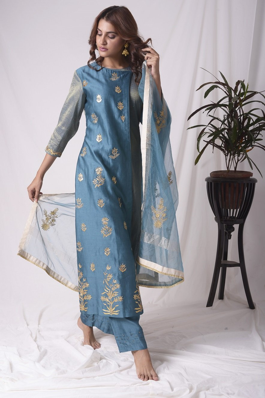 Buy blue tissue chanderi suit online in USA with palazzo and dupatta. Be the talk of parties and weddings with exquisite designer gowns, Indian suits, Anarkali dresses, Indo-western dresses from Pure Elegance Indian clothing store in USA .Shop online now.-full view