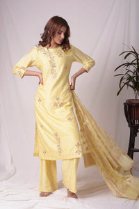 Buy yellow silk suit online in USA with kachi patti work. Be the talk of parties and weddings with exquisite designer gowns, sharara suits, Anarkali suits, salwar suits from Pure Elegance Indian clothing store in USA. Shop online now.-full view