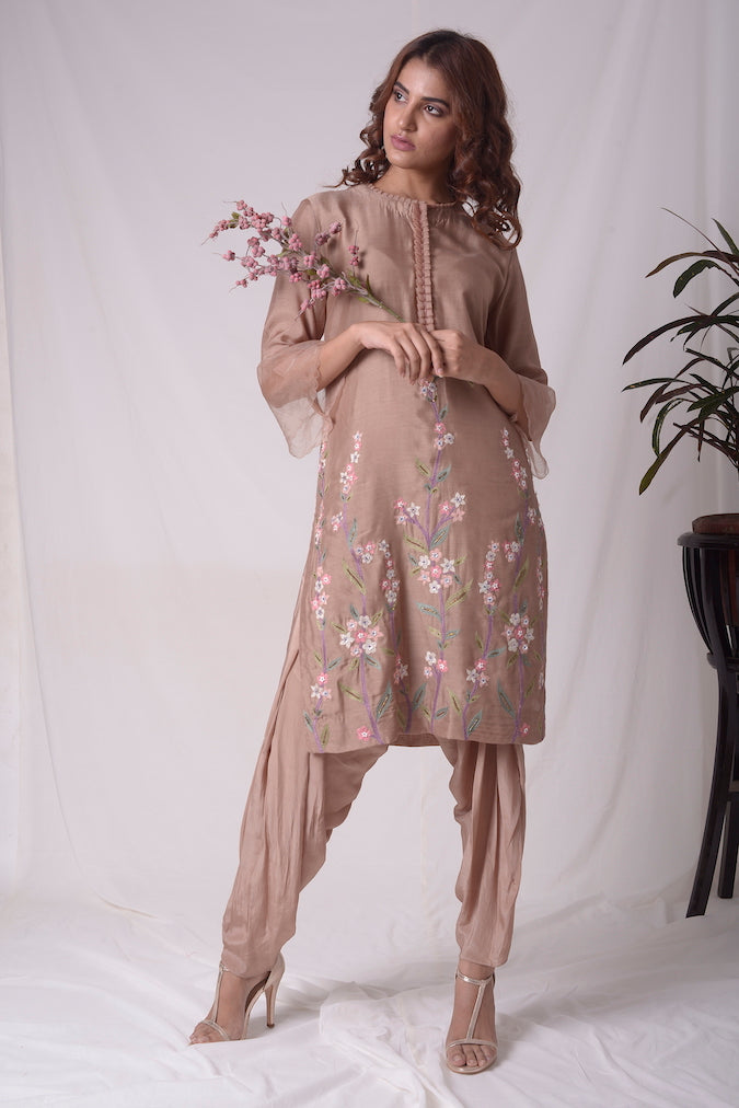 Buy beautiful brown cotton silk suit online in USA. Suit has simple multi color embroidery work. Kurta has 3/4 length sleeves which is net like at border, and dhoti. Simple look makes it elegant. Be the talk of parties and weddings with exquisite designer gowns from Pure Elegance Indian clothing store in USA.-full view