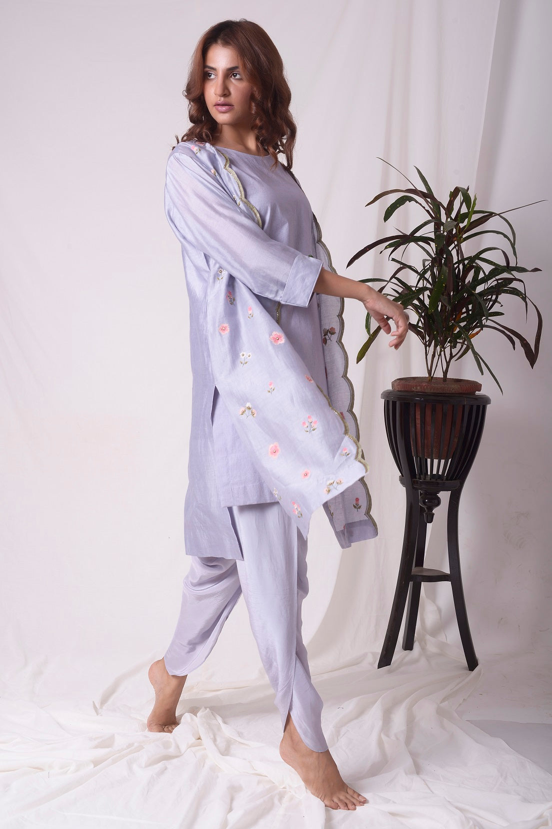 Buy lavender chanderi suit online in USA. Suit has simple red and green work. Kurta has 3/4 length sleeves and purple dhoti.Kurta has jacket like shrug. Simple look makes it elegant. Be the talk of parties and weddings with exquisite designer gowns from Pure Elegance Indian clothing store in USA. Shop online now.-full view-3