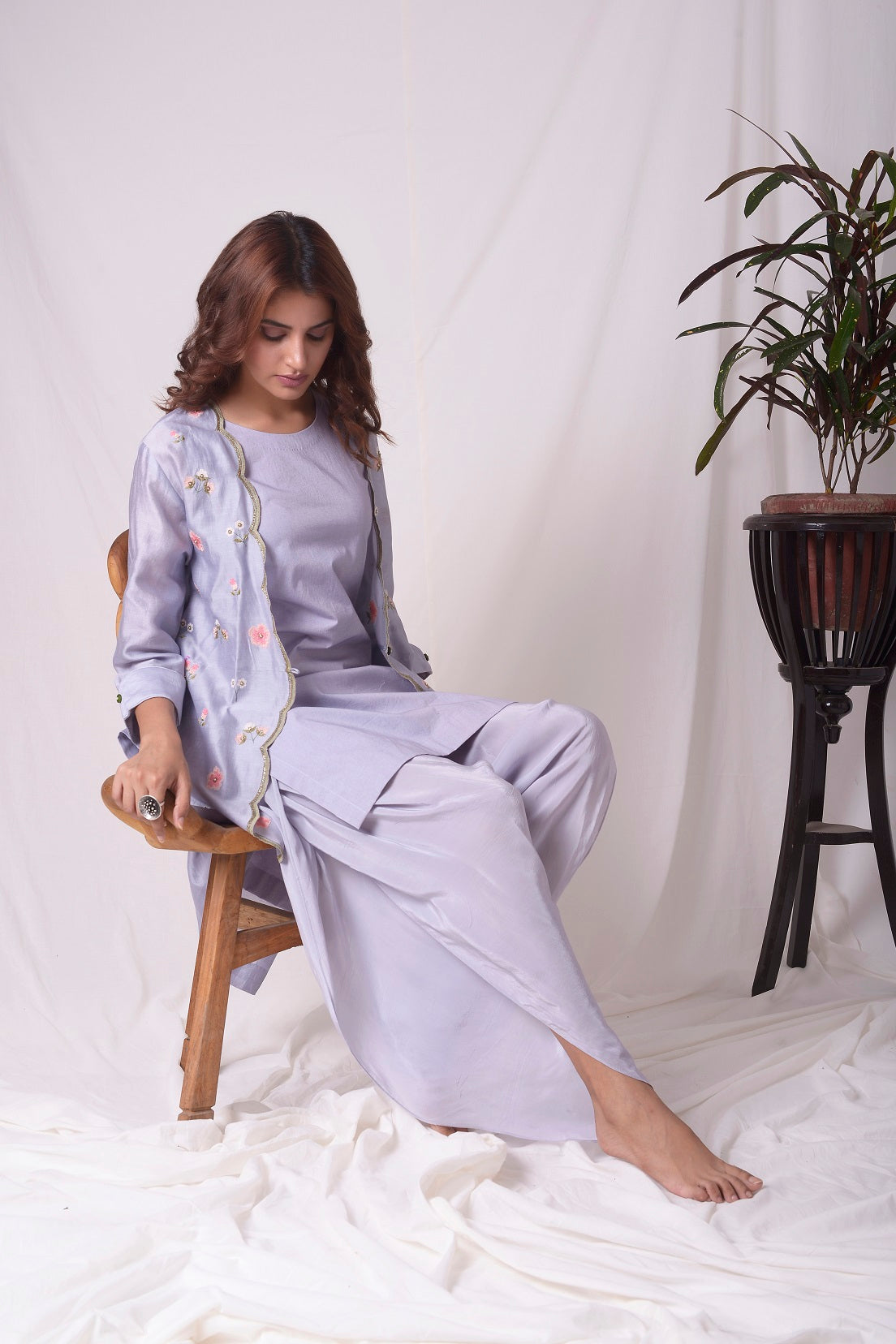 Buy lavender chanderi suit online in USA. Suit has simple red and green work. Kurta has 3/4 length sleeves and purple dhoti.Kurta has jacket like shrug. Simple look makes it elegant. Be the talk of parties and weddings with exquisite designer gowns from Pure Elegance Indian clothing store in USA. Shop online now.-full view