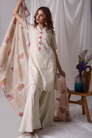 Buy off-white cotton linen suit online USA. Suit has pink design work.It has 3/4 length sleeves with white palazzo and pink duppatta which has mix badi booti. Simple look makes it elegant. Be the talk of parties and weddings with exquisite designer gowns from Pure Elegance Indian clothing store in USA. Shop online now.-full view-2
