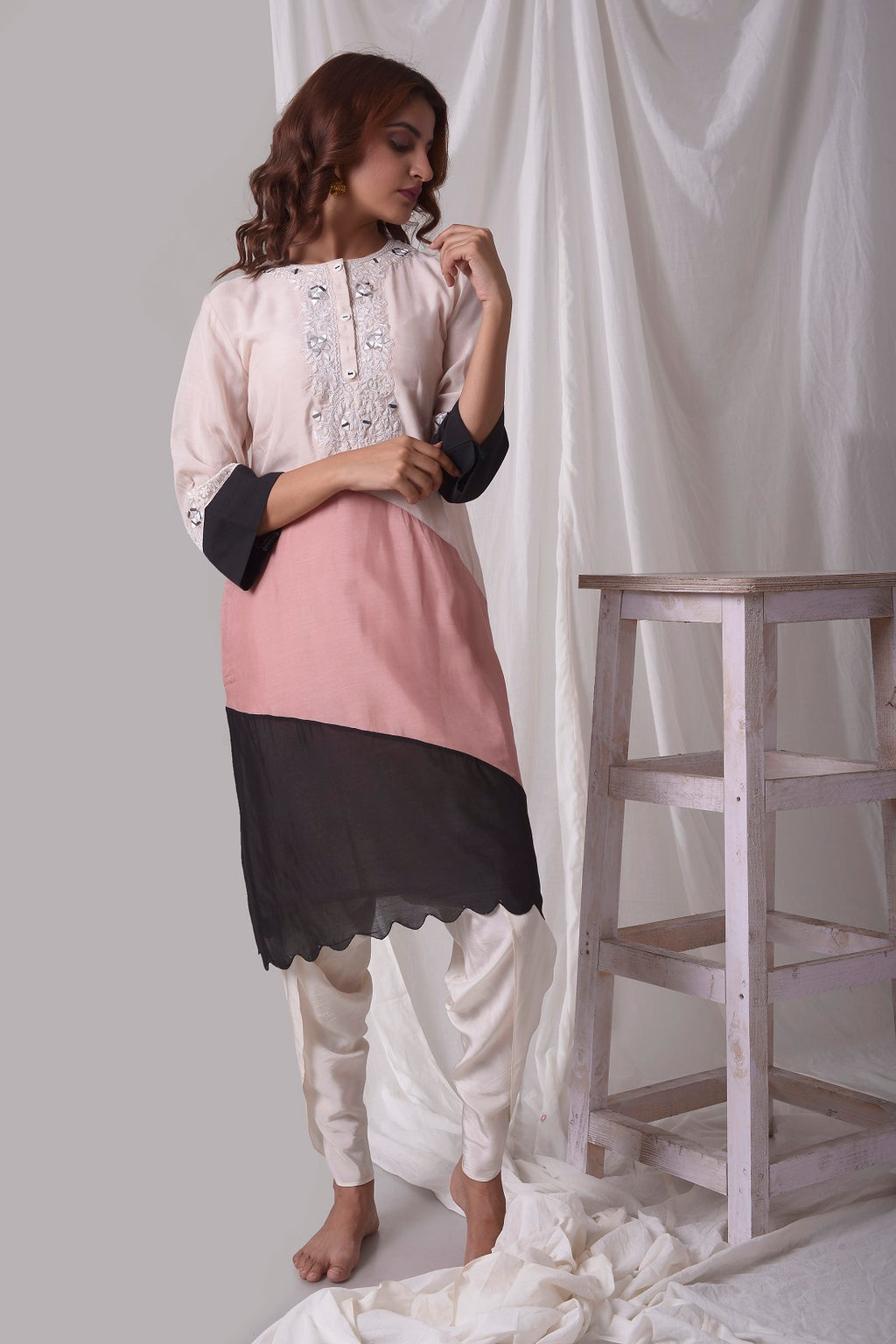 Buy off-white cotton silk suit online in USA. Suit has simple white work. Kurta has 3/4 length sleeves, white dhoti and its multi color with white, pink and black.Simple look makes it elegant. Be the talk of parties and weddings with exquisite designer gowns from Pure Elegance Indian clothing store in USA. Shop online now.-full view