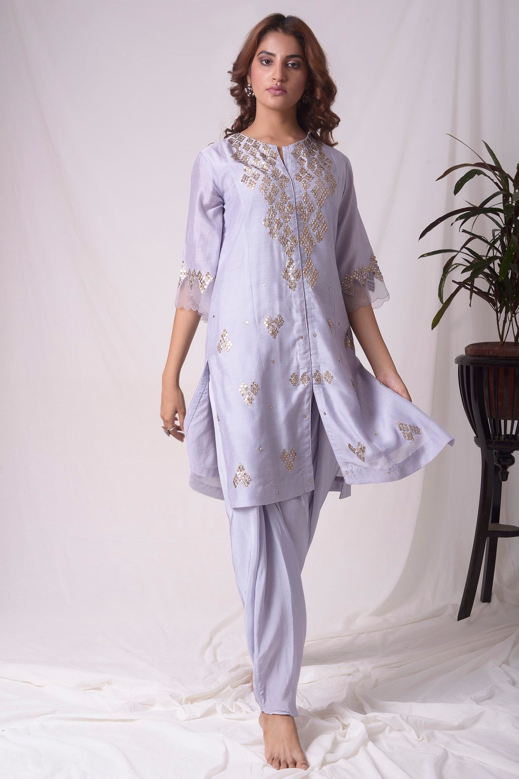 Buy lavender embroidered chanderi suit online in USA. Suit has simple golden work. Kurta has 3/4 length sleeves with net like at border, dhoti and rhombus neckline. Simple look makes it elegant. Be the talk of parties and weddings with exquisite designer gowns from Pure Elegance Indian clothing store in USA. Shop online now.-full view-2