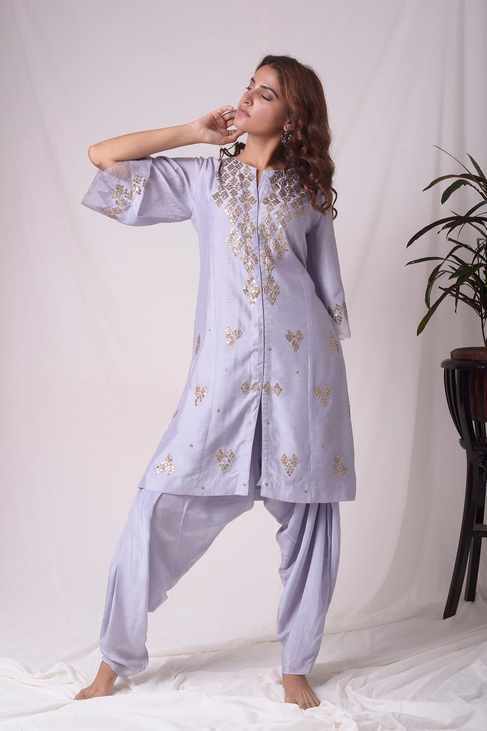 Buy lavender embroidered chanderi suit online in USA. Suit has simple golden work. Kurta has 3/4 length sleeves with net like at border, dhoti and rhombus neckline. Simple look makes it elegant. Be the talk of parties and weddings with exquisite designer gowns from Pure Elegance Indian clothing store in USA. Shop online now.-full view-3