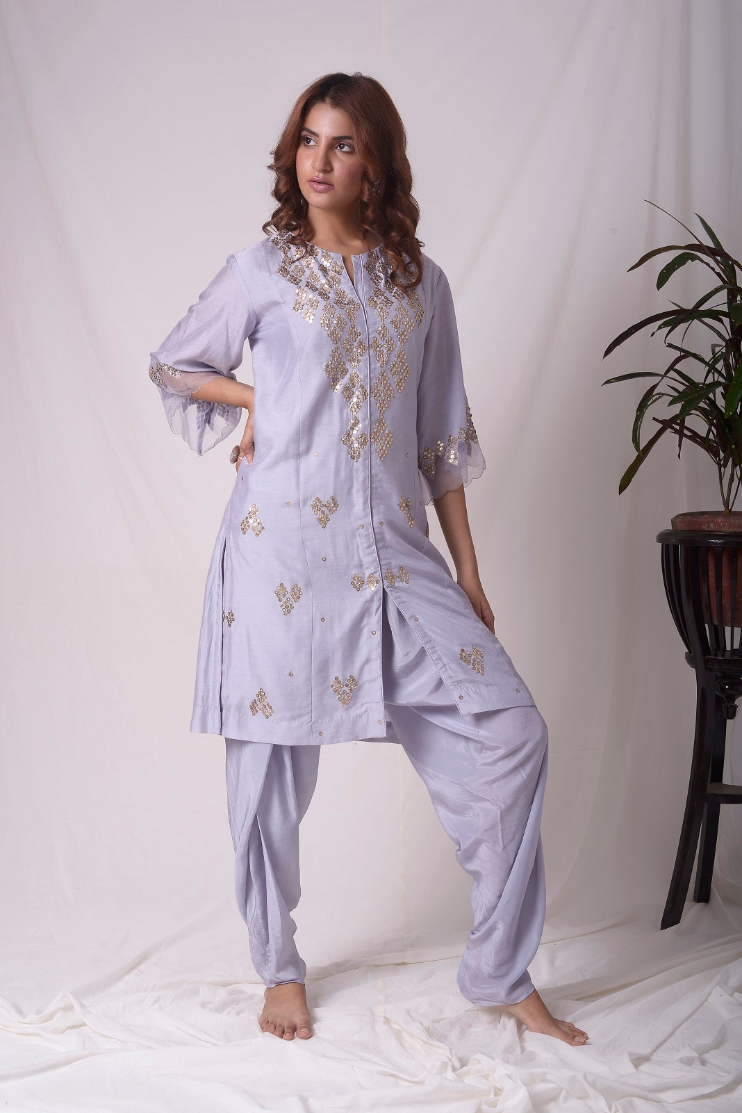 Buy lavender embroidered chanderi suit online in USA. Suit has simple golden work. Kurta has 3/4 length sleeves with net like at border, dhoti and rhombus neckline. Simple look makes it elegant. Be the talk of parties and weddings with exquisite designer gowns from Pure Elegance Indian clothing store in USA. Shop online now.-full view-5