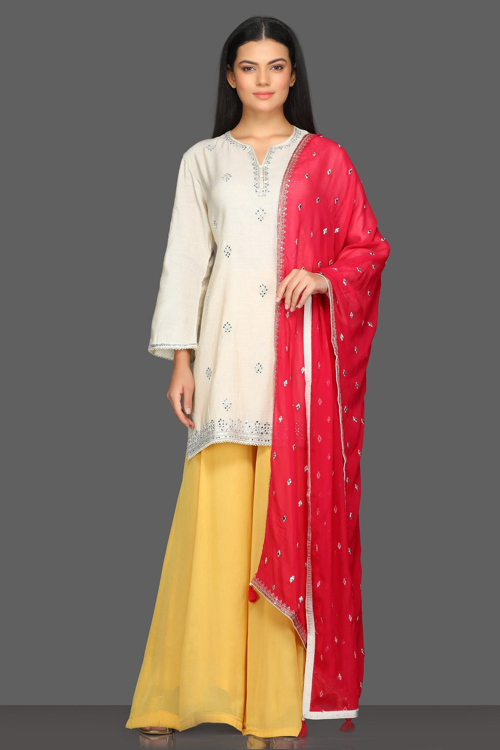 Buy lovely white and yellow embroidered sharara suit online in USA with red dupatta. Dazzle on weddings and special occasions with exquisite Indian designer dresses, sharara suits, Anarkali suits from Pure Elegance Indian fashion store in USA.-full view