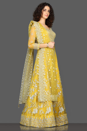 Shop beautiful yellow embroidered Anarkali suit online in USA with matching dupatta. Dazzle on weddings and special occasions with exquisite Indian designer dresses, sharara suits, Anarkali suits from Pure Elegance Indian fashion store in USA.-side
