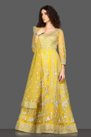 Shop beautiful yellow embroidered Anarkali suit online in USA with matching dupatta. Dazzle on weddings and special occasions with exquisite Indian designer dresses, sharara suits, Anarkali suits from Pure Elegance Indian fashion store in USA.-left