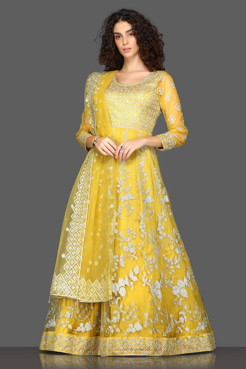 Shop beautiful yellow embroidered Anarkali suit online in USA with matching dupatta. Dazzle on weddings and special occasions with exquisite Indian designer dresses, sharara suits, Anarkali suits from Pure Elegance Indian fashion store in USA.-full view