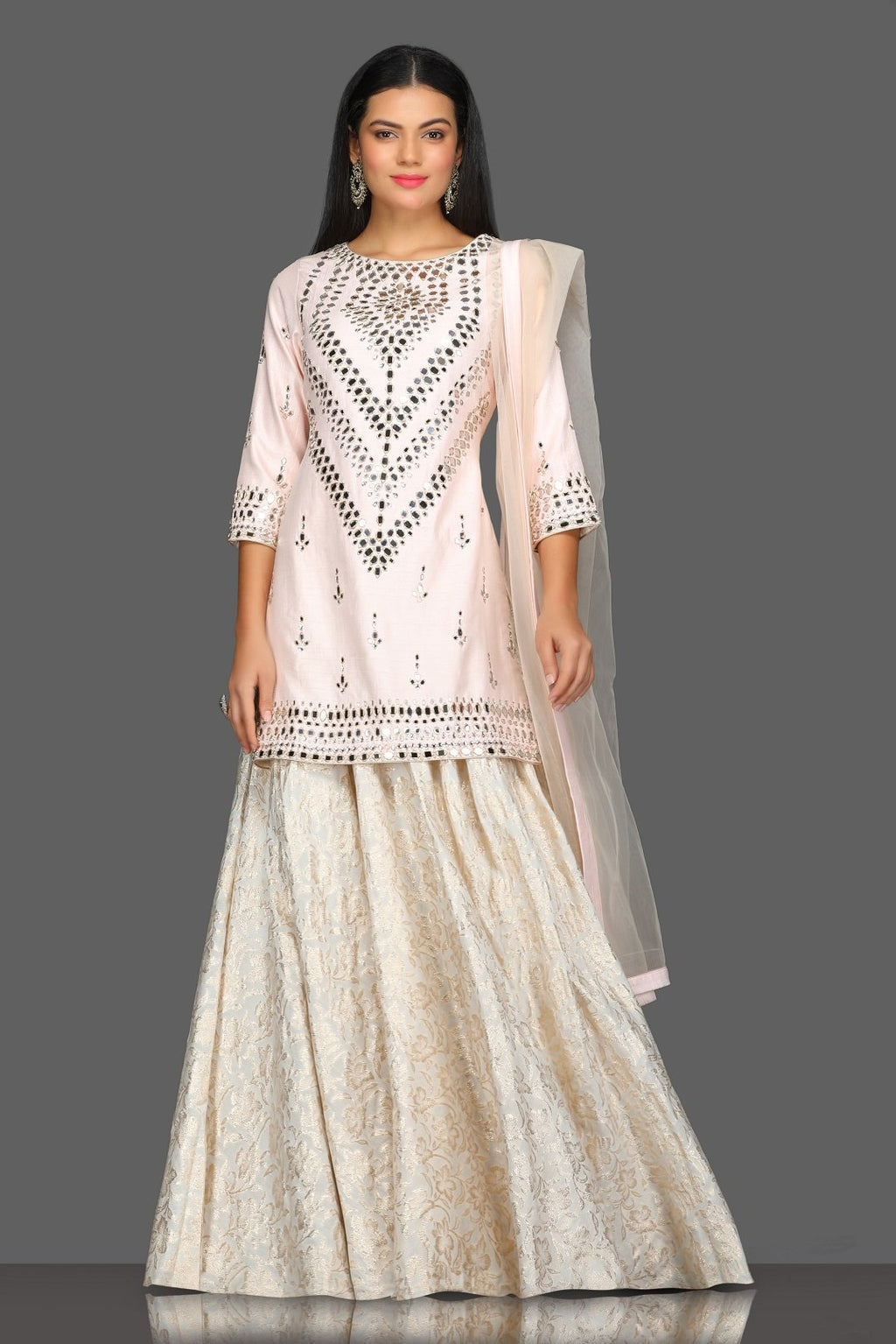 Buy gorgeous powder pink mirror work kurta skirt set online in USA with matching dupatta. Dazzle on weddings and special occasions with exquisite Indian designer dresses, sharara suits, Anarkali suits from Pure Elegance Indian fashion store in USA.-full view