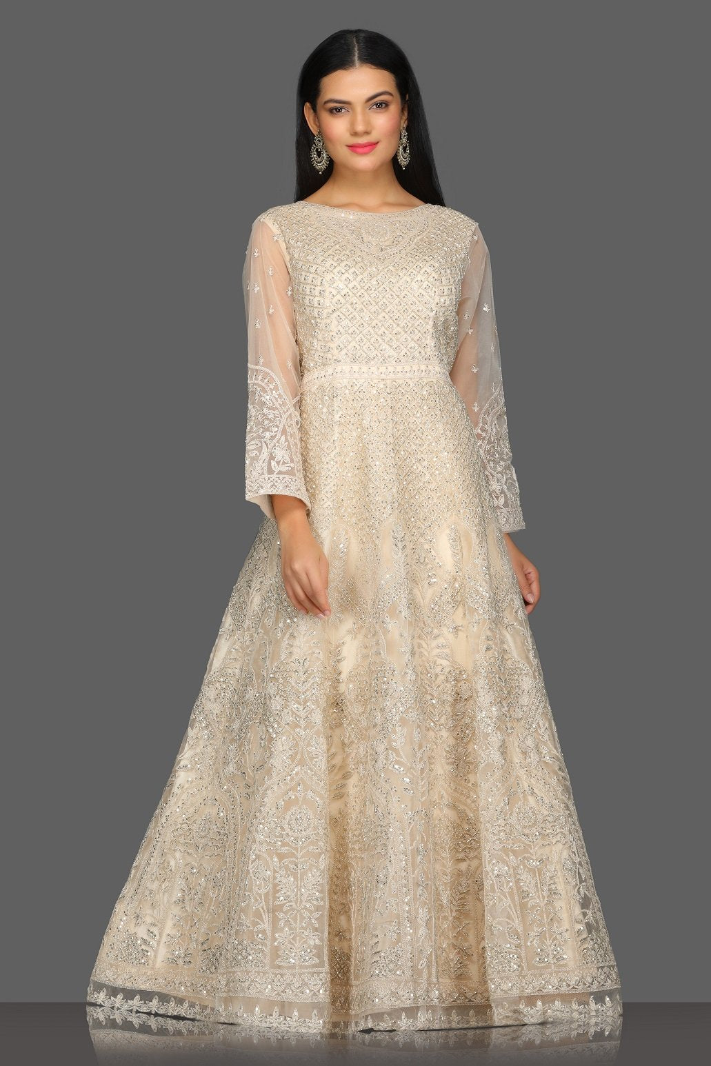 Buy gorgeous beige embroidered floorlength Anarkali suit online in USA with dupatta. Dazzle on weddings and special occasions with exquisite Indian designer dresses, sharara suits, Anarkali suits from Pure Elegance Indian fashion store in USA.-front
