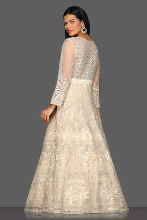 Buy gorgeous beige embroidered floorlength Anarkali suit online in USA with dupatta. Dazzle on weddings and special occasions with exquisite Indian designer dresses, sharara suits, Anarkali suits from Pure Elegance Indian fashion store in USA.-back