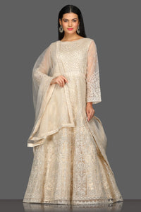 Buy gorgeous beige embroidered floorlength Anarkali suit online in USA with dupatta. Dazzle on weddings and special occasions with exquisite Indian designer dresses, sharara suits, Anarkali suits from Pure Elegance Indian fashion store in USA.-full view