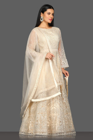 Buy gorgeous beige embroidered floorlength Anarkali suit online in USA with dupatta. Dazzle on weddings and special occasions with exquisite Indian designer dresses, sharara suits, Anarkali suits from Pure Elegance Indian fashion store in USA.-right