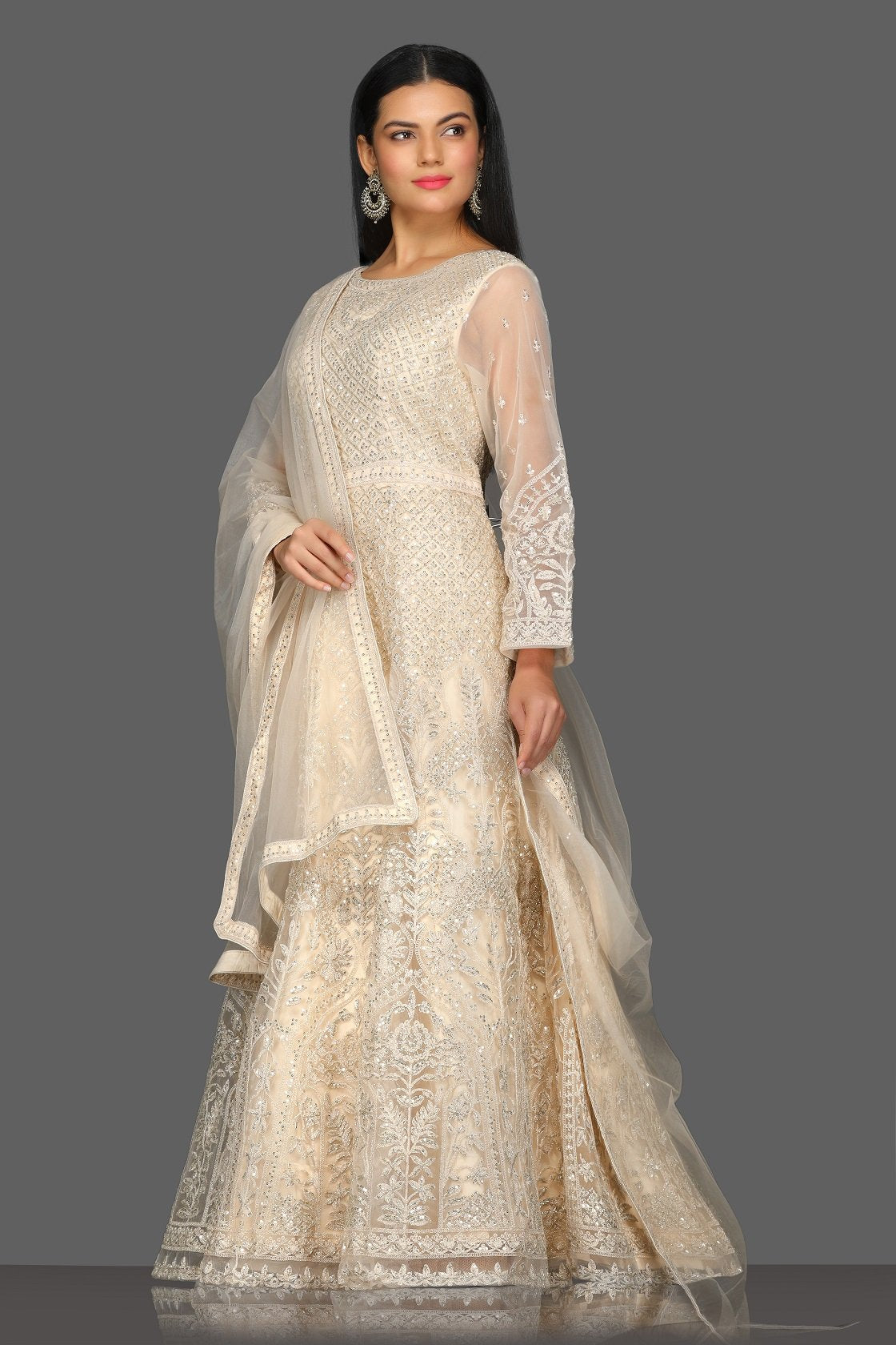 Buy gorgeous beige embroidered floorlength Anarkali suit online in USA with dupatta. Dazzle on weddings and special occasions with exquisite Indian designer dresses, sharara suits, Anarkali suits from Pure Elegance Indian fashion store in USA.-side