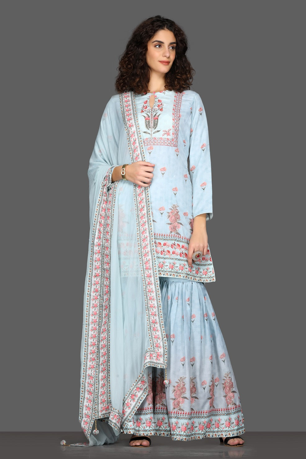 Shop beautiful powder blue floral gharara suit online in USA and matching dupatta. Dazzle on weddings and special occasions with exquisite Indian designer dresses, sharara suits, Anarkali suits from Pure Elegance Indian fashion store in USA.-full view