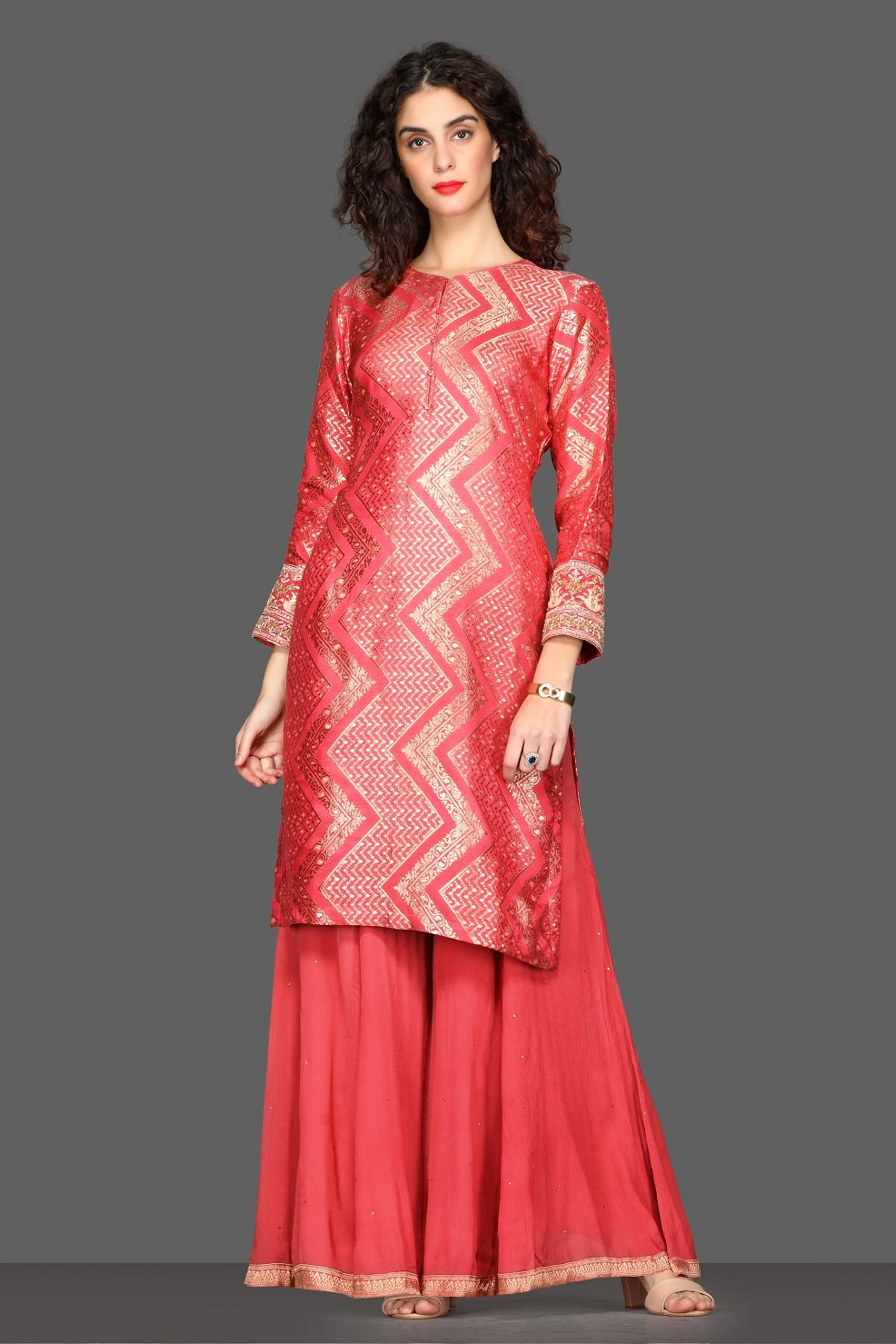 Shop stunning pink palazzo suit online in USA with green velvet dupatta. Dazzle on weddings and special occasions with exquisite Indian designer lehengas, sharara suits, Anarkali suits from Pure Elegance Indian fashion store in USA.-front