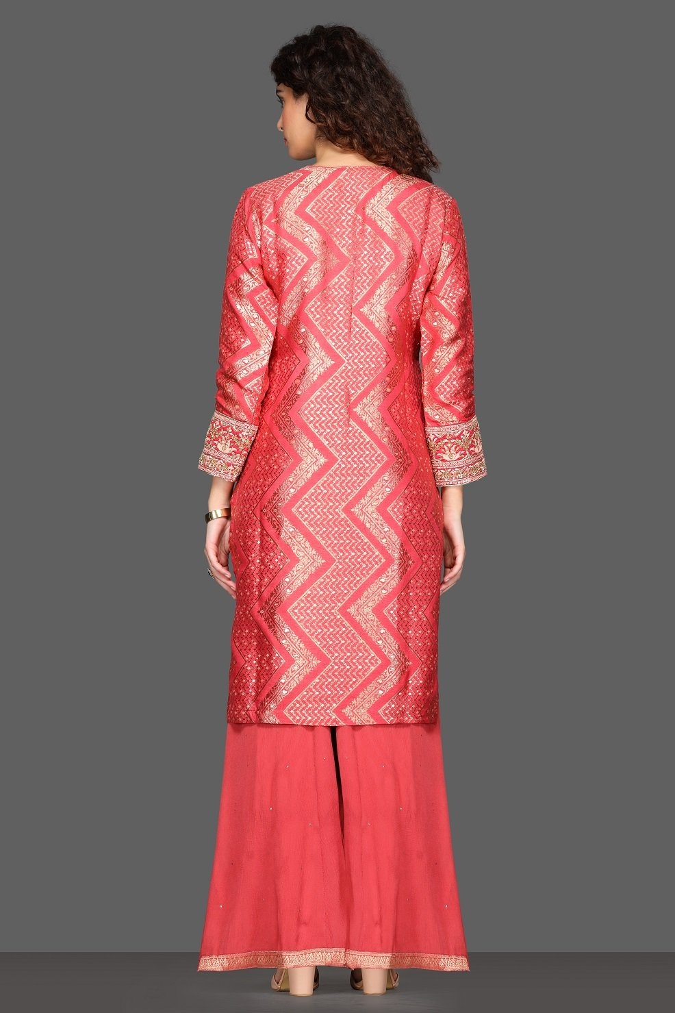 Shop stunning pink palazzo suit online in USA with green velvet dupatta. Dazzle on weddings and special occasions with exquisite Indian designer lehengas, sharara suits, Anarkali suits from Pure Elegance Indian fashion store in USA.-back