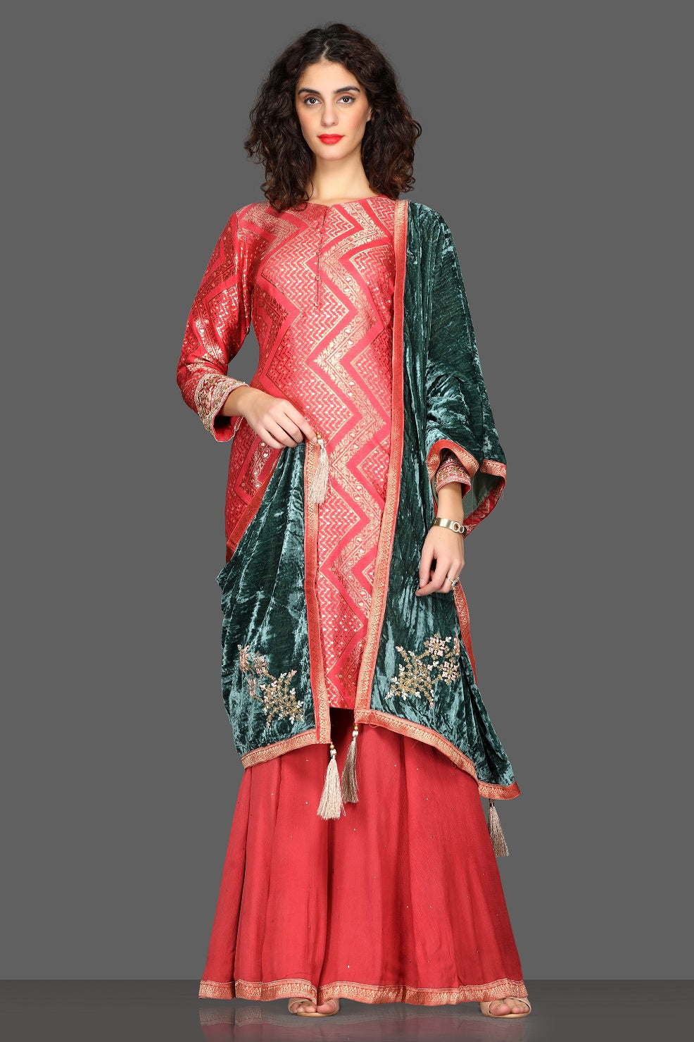 Shop stunning pink palazzo suit online in USA with green velvet dupatta. Dazzle on weddings and special occasions with exquisite Indian designer lehengas, sharara suits, Anarkali suits from Pure Elegance Indian fashion store in USA.-full view