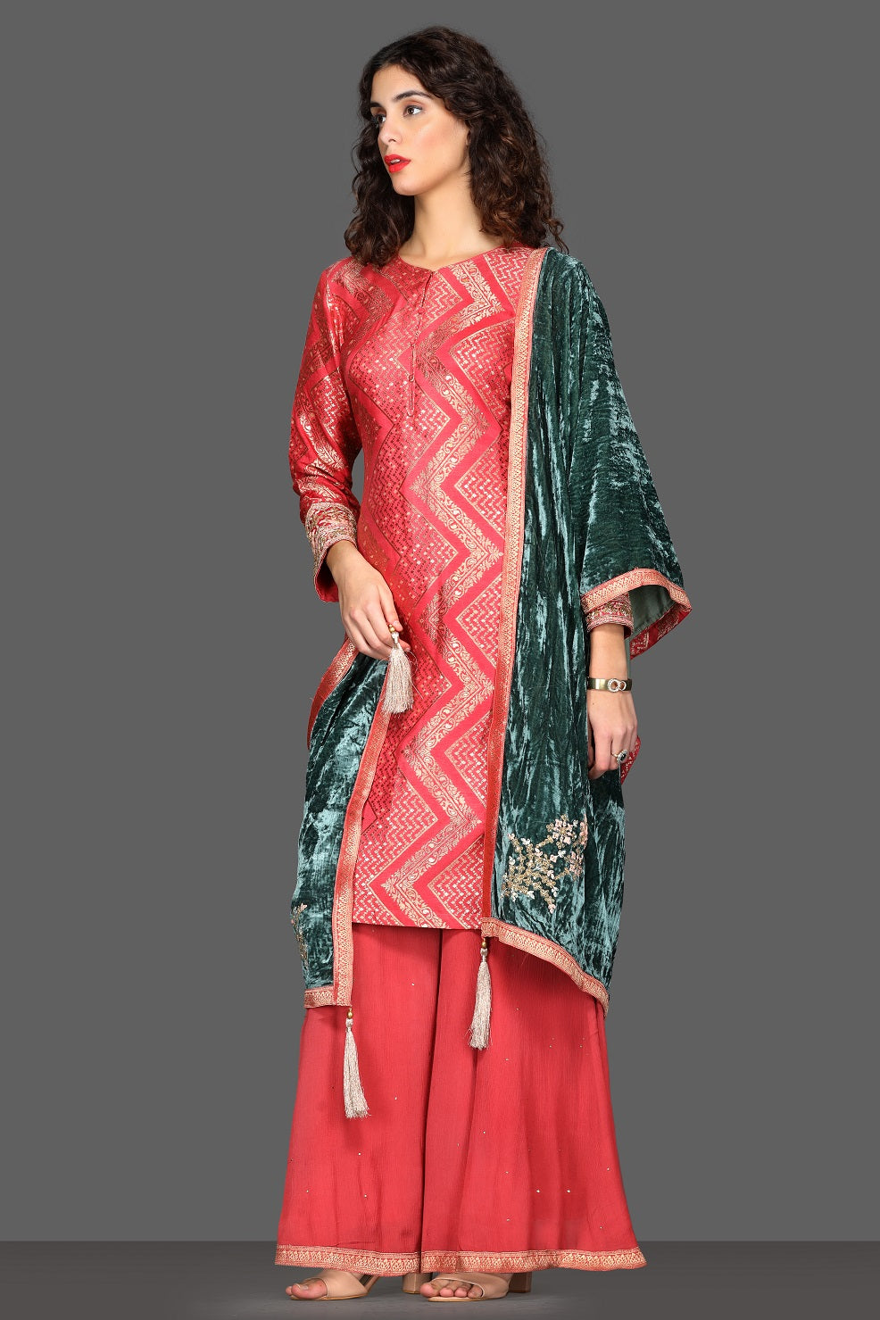Shop stunning pink palazzo suit online in USA with green velvet dupatta. Dazzle on weddings and special occasions with exquisite Indian designer lehengas, sharara suits, Anarkali suits from Pure Elegance Indian fashion store in USA.-left