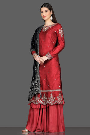 Shop gorgeous red embroidered palazzo suit online in USA with black velvet dupatta. Dazzle on weddings and special occasions with exquisite Indian designer dresses, sharara suits, Anarkali suits from Pure Elegance Indian fashion store in USA.-left