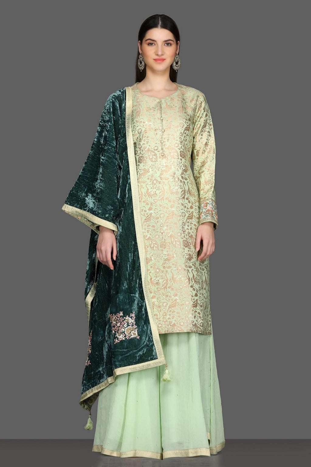 Shop beautiful mint green palazzo suit online in USA with green velvet dupatta. Dazzle on weddings and special occasions with exquisite Indian designer dresses, sharara suits, Anarkali suits from Pure Elegance Indian fashion store in USA.-full view