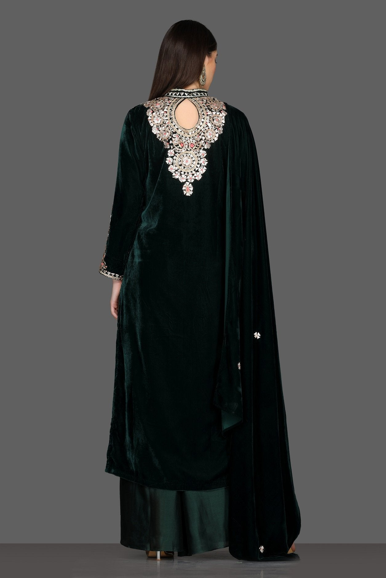 Buy gorgeous bottle green embroidered velvet palazzo suit online in USA with dupatta. Dazzle on weddings and special occasions with exquisite Indian designer lehengas, sharara suits, Anarkali suits, Indowestern dresses from Pure Elegance Indian fashion store in USA.-back
