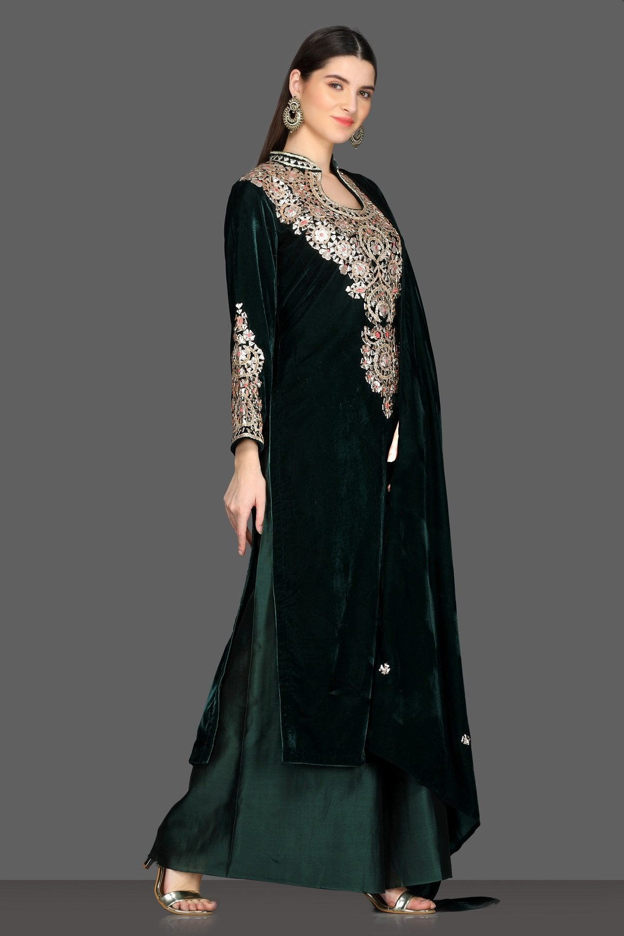 Buy gorgeous bottle green embroidered velvet palazzo suit online in USA with dupatta. Dazzle on weddings and special occasions with exquisite Indian designer lehengas, sharara suits, Anarkali suits, Indowestern dresses from Pure Elegance Indian fashion store in USA.-right