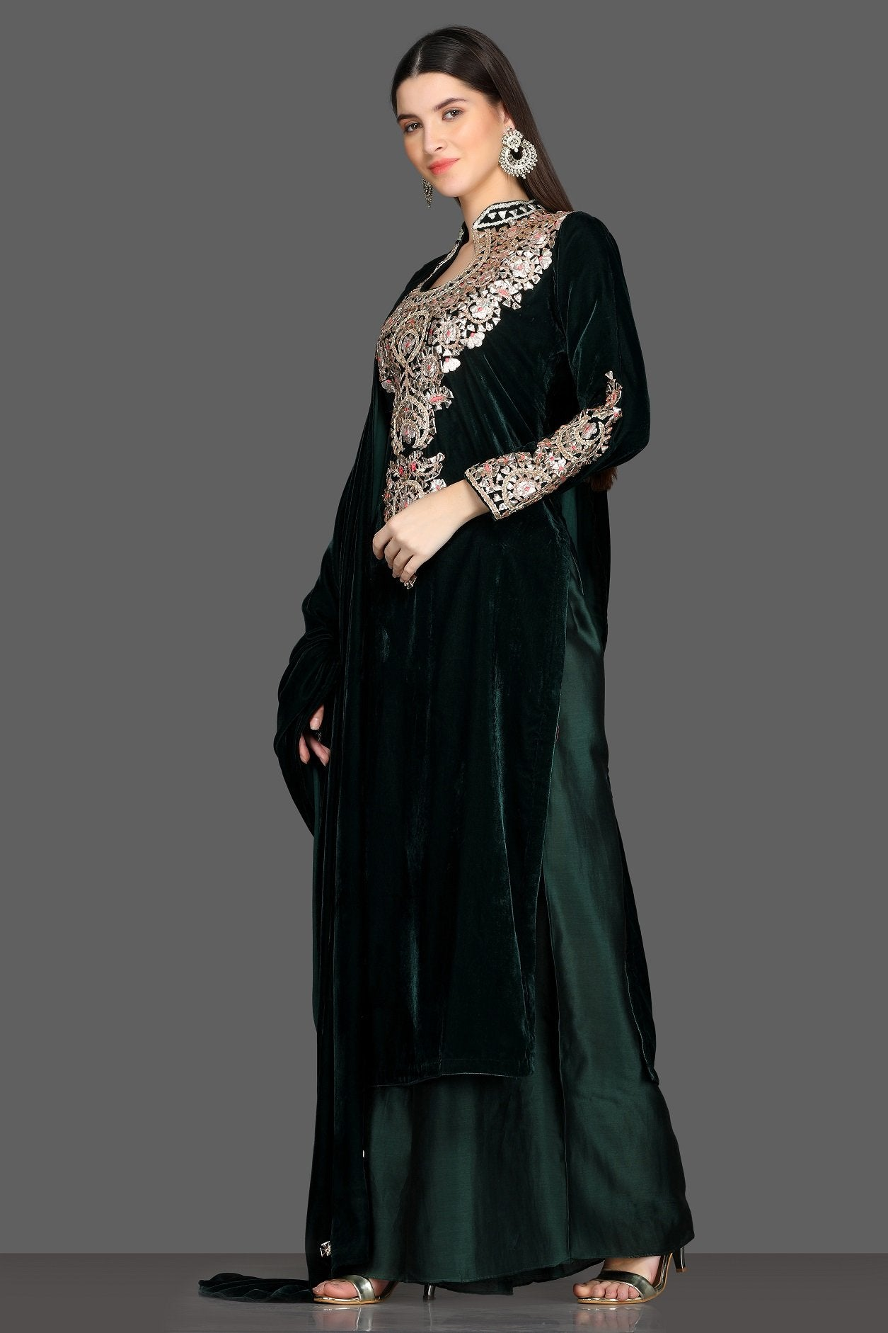 Buy gorgeous bottle green embroidered velvet palazzo suit online in USA with dupatta. Dazzle on weddings and special occasions with exquisite Indian designer lehengas, sharara suits, Anarkali suits, Indowestern dresses from Pure Elegance Indian fashion store in USA.-left