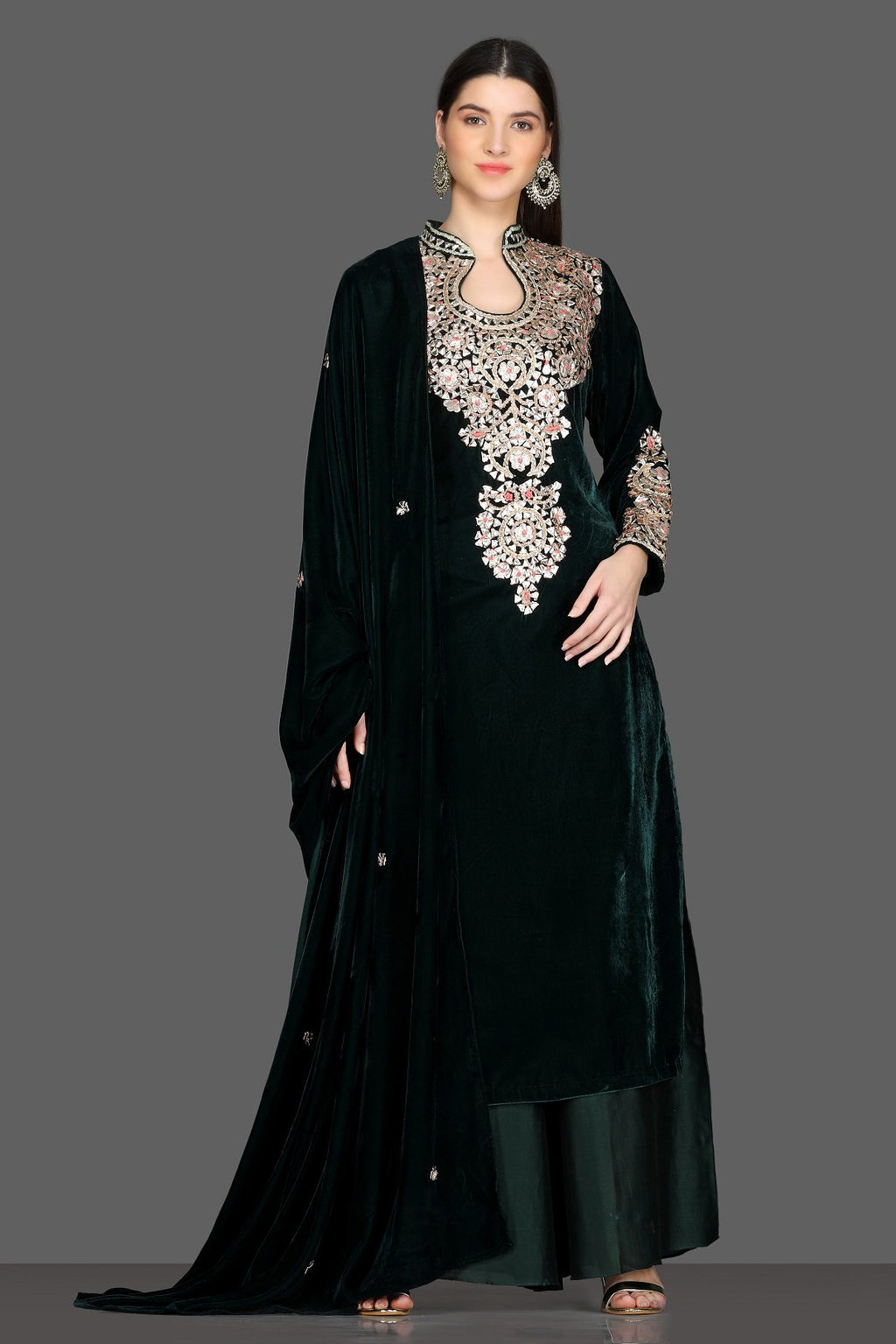 Buy gorgeous bottle green embroidered velvet palazzo suit online in USA with dupatta. Dazzle on weddings and special occasions with exquisite Indian designer lehengas, sharara suits, Anarkali suits, Indowestern dresses from Pure Elegance Indian fashion store in USA.-full view