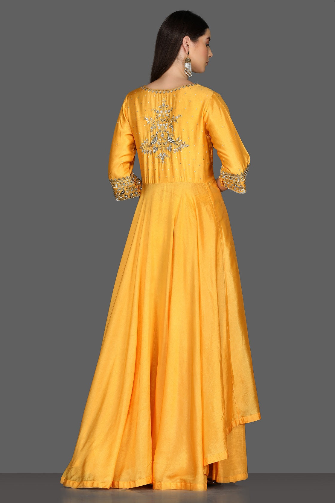 Buy yellow embroidered asymmetric palazzo suit online in USA. Dazzle on weddings and special occasions with exquisite Indian designer dresses, sharara suits, Anarkali suits from Pure Elegance Indian fashion store in USA.-back