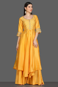 Buy yellow embroidered asymmetric palazzo suit online in USA. Dazzle on weddings and special occasions with exquisite Indian designer dresses, sharara suits, Anarkali suits from Pure Elegance Indian fashion store in USA.-full view