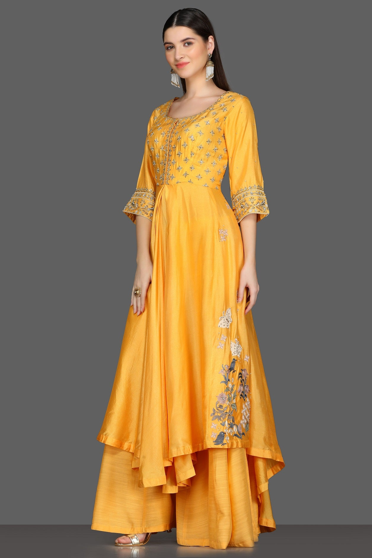 Buy yellow embroidered asymmetric palazzo suit online in USA. Dazzle on weddings and special occasions with exquisite Indian designer dresses, sharara suits, Anarkali suits from Pure Elegance Indian fashion store in USA.-left