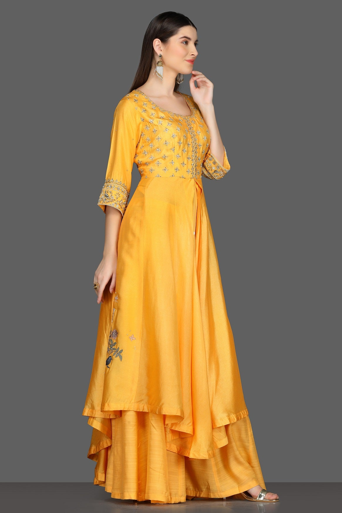 Buy yellow embroidered asymmetric palazzo suit online in USA. Dazzle on weddings and special occasions with exquisite Indian designer dresses, sharara suits, Anarkali suits from Pure Elegance Indian fashion store in USA.-right