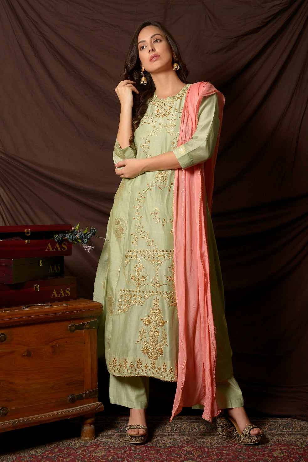 Buy gorgeous dusty green embroidered chanderi suit online in USA with pink dupatta. Shine at weddings and special occasions with beautiful Indian designer suits, gowns, lehengas from Pure Elegance Indian clothing store in USA.-full view